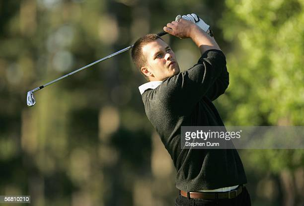 Quarterback Tom Brady of the New England Patriots hits his tee shot on the second hole during the first round of the ATT Pro Am on February 9 2006 at...