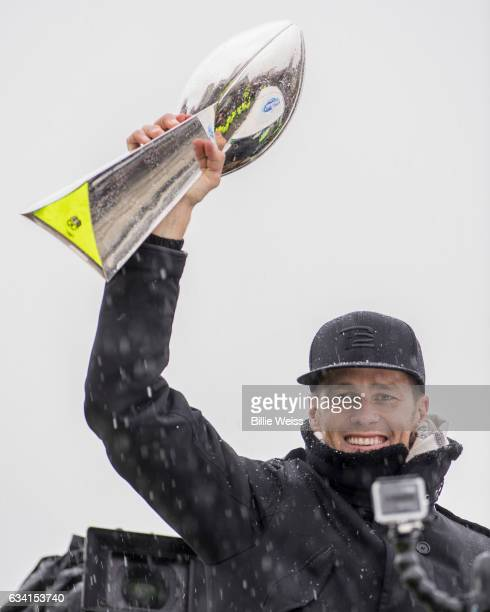 Quarterback Tom Brady of the New England Patriots holds the Vince Lombardi trophy during the Super Bowl victory parade on February 7 2017 in Boston...