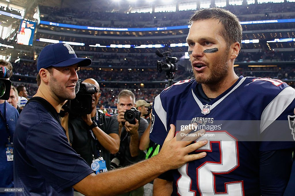 Quarterback Tom Brady #12 of the New England Patriots is congratulated by Tony Romo #9 of the Dallas Cowboys after the Patriots defeated the Cowboys 30-6 in the NFL game at AT&T Stadium on October 11, 2015 in Arlington, Texas.