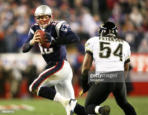 Quarterback Tom Brady of the New England Patriots is pursued by Mike Peterson of the Jacksonville Jaguars in the first quarter of their AFC Wildcard...