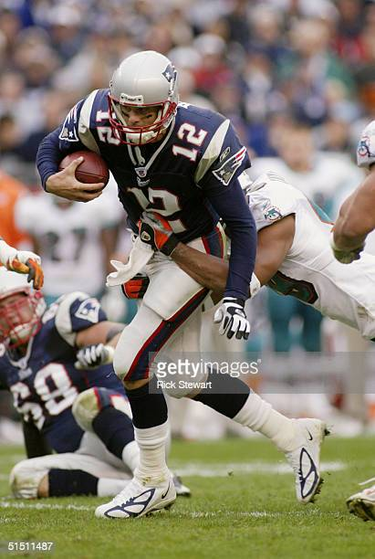 Quarterback Tom Brady of the New England Patriots is sacked by the Miami Dolphins during the game at Gillette Stadium on October 10, 2004 in Foxboro,...