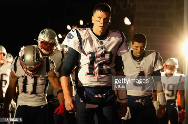 Quarterback Tom Brady of the New England Patriots leads his team onto the field before the game against the New York Jets at MetLife Stadium on...