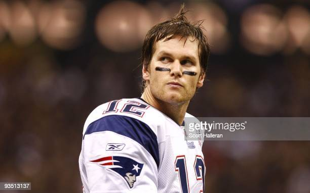 Quarterback Tom Brady of the New England Patriots looks on as he walks back to the sideline after failing to get a first down on a fourth down play...