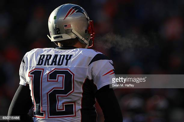 Quarterback Tom Brady of the New England Patriots looks on during a game against the Denver Broncos at Sports Authority Field at Mile High on...