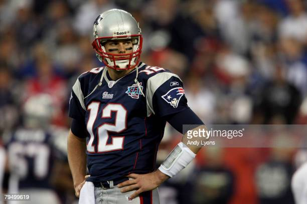 Quarterback Tom Brady of the New England Patriots looks on during Super Bowl XLII against the New York Giants on February 3 2008 at the University of...