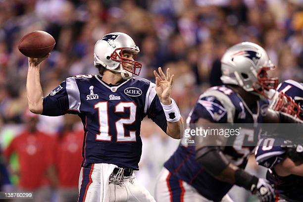 Quarterback Tom Brady of the New England Patriots looks to throw against the New York Giants during Super Bowl XLVI at Lucas Oil Stadium on February...