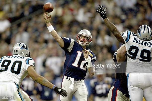 Quarterback Tom Brady of the New England Patriots passes against the Carolina Panthers during the second quarter of Super Bowl XXXVIII at Reliant...