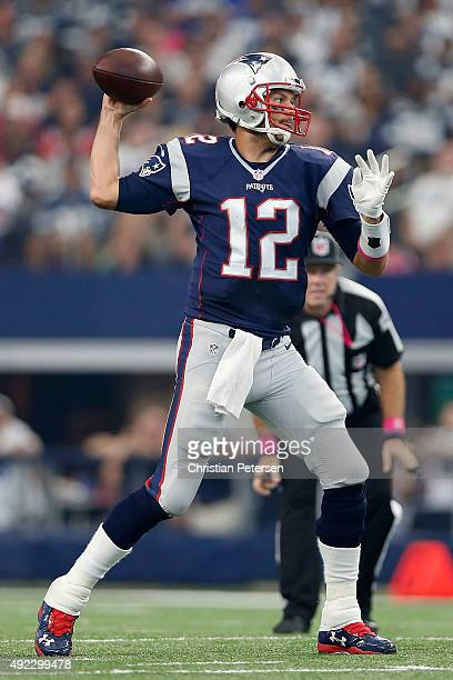 Quarterback Tom Brady of the New England Patriots passes against the Dallas Cowboys during the first half of the NFL game at ATT Stadium on October...