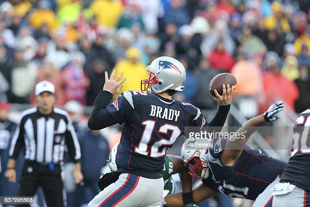 Quarterback Tom Brady of the New England Patriots passes the ball against the New York Jets at Gillette Stadium on December 24 2016 in Foxboro...