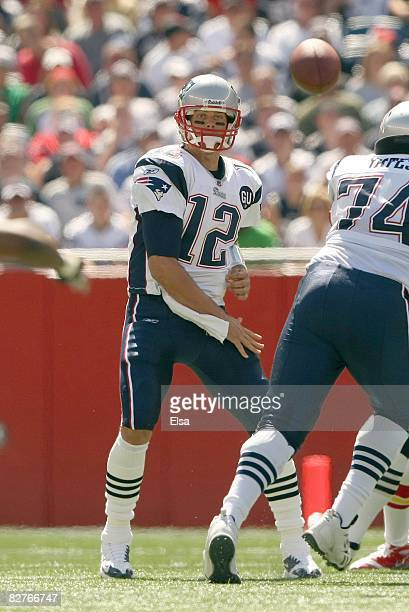 Quarterback Tom Brady of the New England Patriots passes the ball up the middle during their NFL game against the Kansas City Chiefs on September 7...