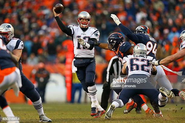 Quarterback Tom Brady of the New England Patriots passes under pressure by inside linebacker Corey Nelson of the Denver Broncos in the third quarter...