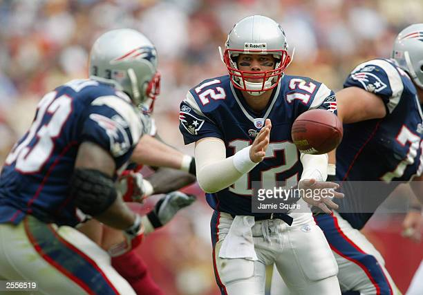 Quarterback Tom Brady of the New England Patriots pitches back to Kevin Faulk during the game against the Washington Redskins on September 28, 2003...