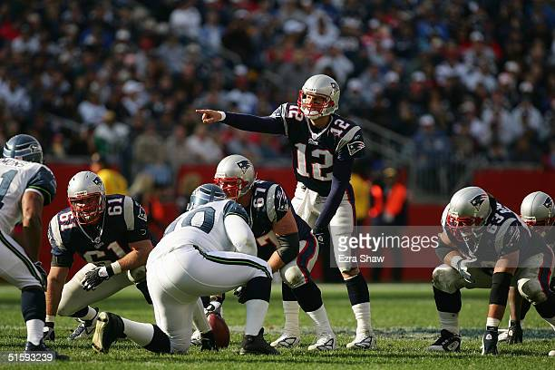 Quarterback Tom Brady of the New England Patriots points out the defense during the game with the Seattle Seahawks at Gillette Stadium on October 17...