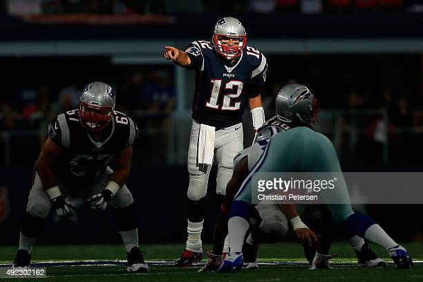 Quarterback Tom Brady of the New England Patriots prepares to snap the football during the second half of the NFL game against the Dallas Cowboys at...