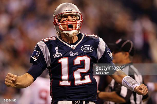 Quarterback Tom Brady of the New England Patriots reacts after throwing a 12 yard touchdown pass to Aaron Hernandez against the New York Giants...