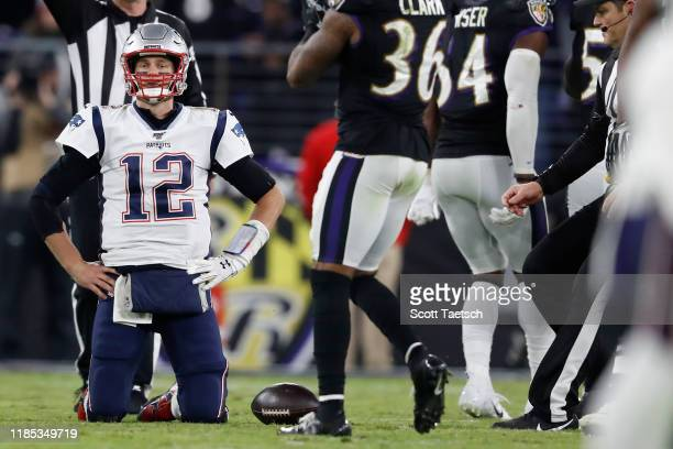 Quarterback Tom Brady of the New England Patriots reacts after being sacked against the Baltimore Ravens during the fourth quarter MT Bank Stadium on...