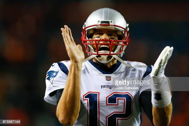 Quarterback Tom Brady of the New England Patriots reacts as he walks on the field before a game against the Denver Broncos at Sports Authority Field...