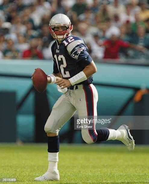Quarterback Tom Brady of the New England Patriots rolls out to pass during the NFL game against the Philadelphia Eagles on September 14 2003 at...