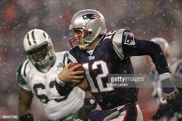 Quarterback Tom Brady of the New England Patriots runs with the ball during the game against the New York Jets at Gillette Stadium on December 4 2005...