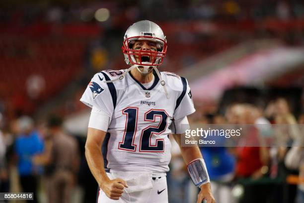 Quarterback Tom Brady of the New England Patriots screams on the field before the start of an NFL football game against the Tampa Bay Buccaneers on...