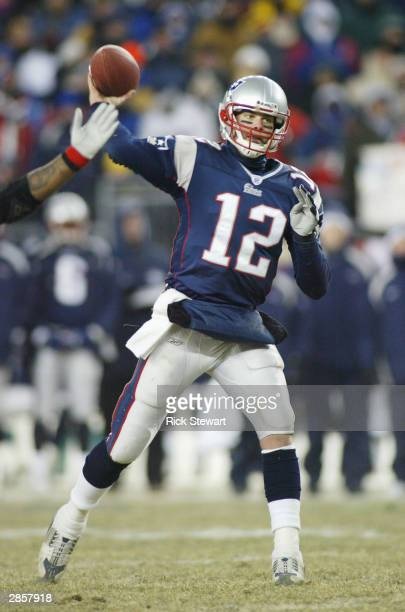 Quarterback Tom Brady of the New England Patriots sets to throw a pass against the Tennessee Titans in the first quarter during the AFC divisional...