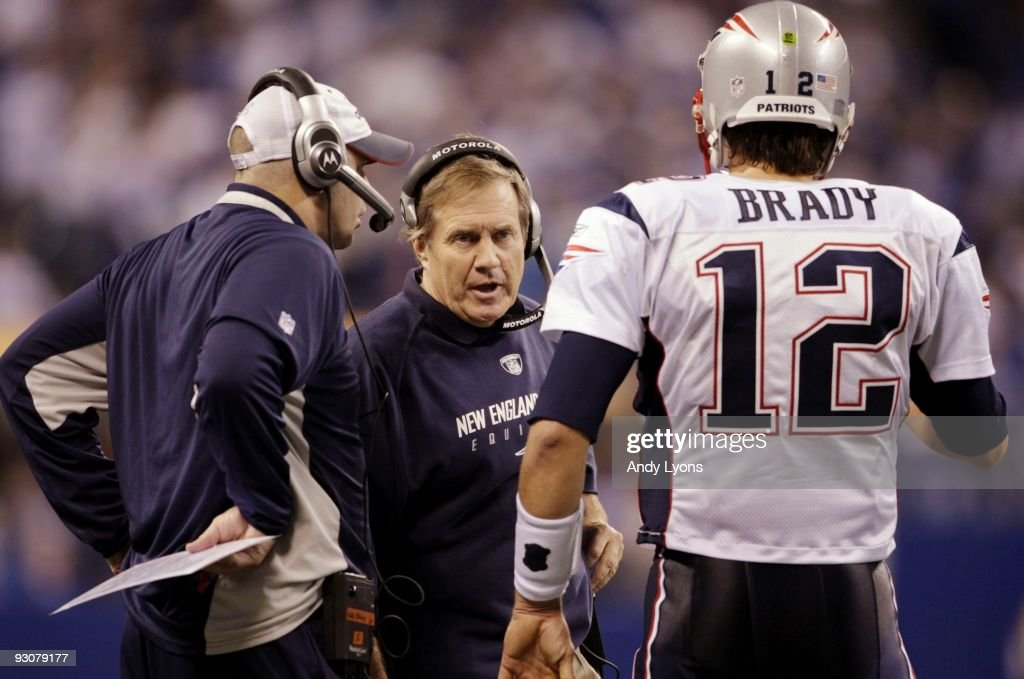 Quarterback Tom Brady #12 of the New England Patriots speaks to head coach Bill Belichick in the fourth quarter of the game against the Indianapolis Colts at Lucas Oil Stadium on November 15, 2009 in Indianapolis, Indiana. The Colts won the game 35-34.
