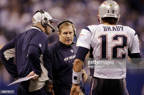 Quarterback Tom Brady of the New England Patriots speaks to head coach Bill Belichick in the fourth quarter of the game against the Indianapolis...