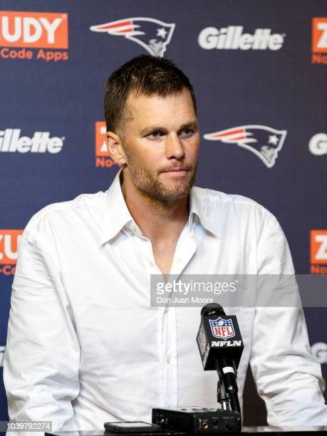 Quarterback Tom Brady of the New England Patriots talk with the media during the post game press conference after the game against the Jacksonville...