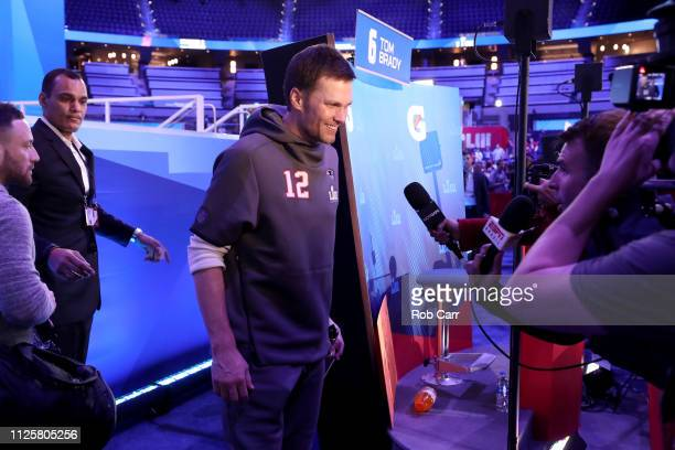 Quarterback Tom Brady of the New England Patriots talks to the media during Super Bowl LIII Opening Night at State Farm Arena on January 28 2019 in...