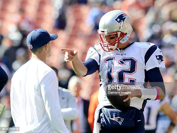 Quarterback Tom Brady of the New England Patriots talks with a ball boy prior to a game against the Cleveland Browns on October 9 2016 at FirstEnergy...