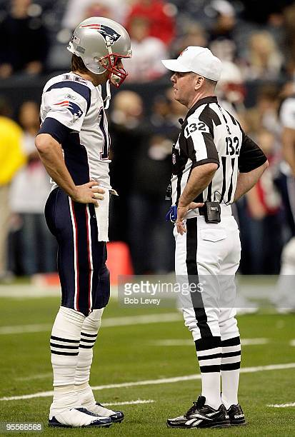 Quarterback Tom Brady of the New England Patriots talks with referee John Parry prior to the game against the Houston Texans at Reliant Stadium on...