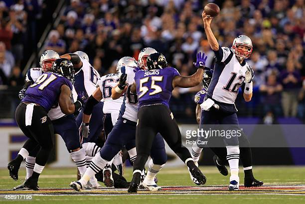 Quarterback Tom Brady of the New England Patriots throws a first half pass against the Baltimore Ravens at MT Bank Stadium on December 22 2013 in...