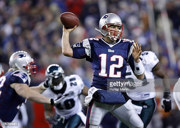 Quarterback Tom Brady of the New England Patriots throws a pass during a game against the Philadelphia Eagles on November 25 2007 at Gillette Stadium...