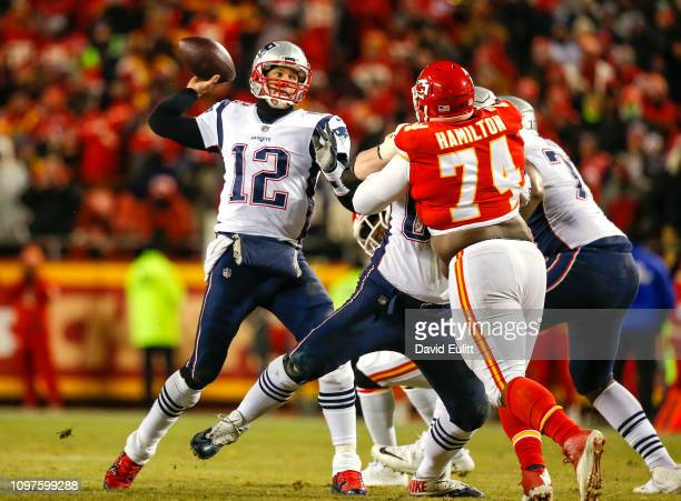 Quarterback Tom Brady of the New England Patriots throws a pass over defensive tackle Justin Hamilton of the Kansas City Chiefs in overtime during...