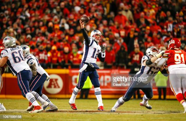 Quarterback Tom Brady of the New England Patriots throws a pass against the Kansas City Chiefs in overtime during the AFC Championship Game at...