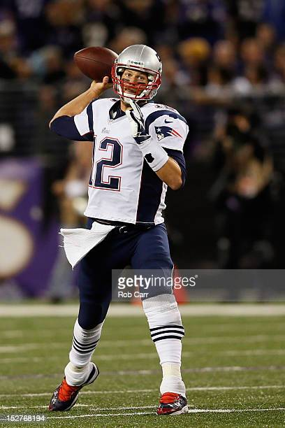 Quarterback Tom Brady of the New England Patriots throws a pass against the Baltimore Ravens at MT Bank Stadium on September 23 2012 in Baltimore...