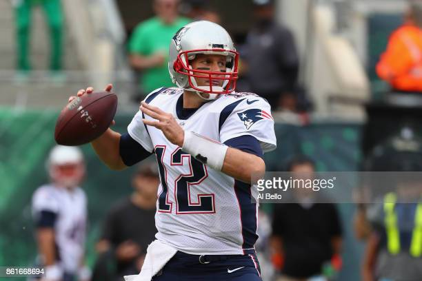 Quarterback Tom Brady of the New England Patriots throws a pass against the New York Jets during the first half of their game at MetLife Stadium on...