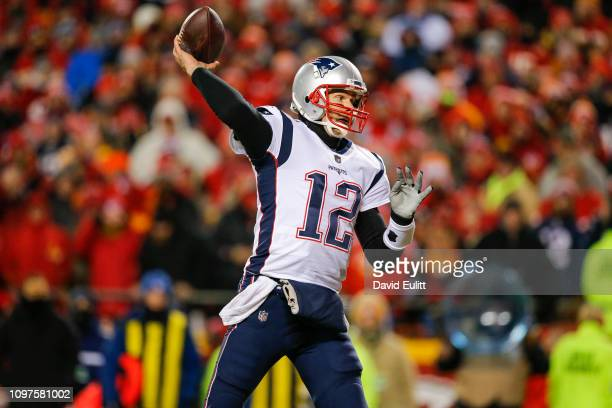 Quarterback Tom Brady of the New England Patriots throws an interception in the Patriots' end zone in the first quarter during the AFC Championship...