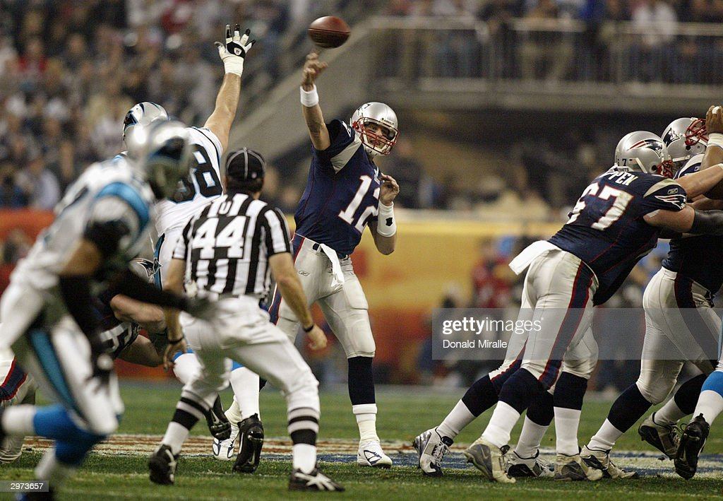 Quarterback Tom Brady #12 of the New England Patriots throws the ball against the Carolina Panthers during Super Bowl XXXVIII at Reliant Stadium on February 1, 2004 in Houston, Texas. The Patriots won 32-29 to claim their second Super Bowl in three years.