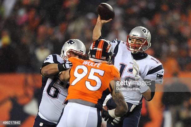 Quarterback Tom Brady of the New England Patriots throws the ball while guard Josh Kline of the New England Patriots blocks against defensive end...