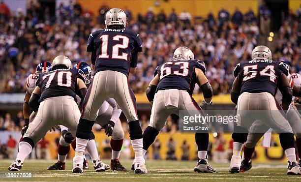 Quarterback Tom Brady of the New England Patriots under center while taking on the New York Giants in the first half during Super Bowl XLVI at Lucas...