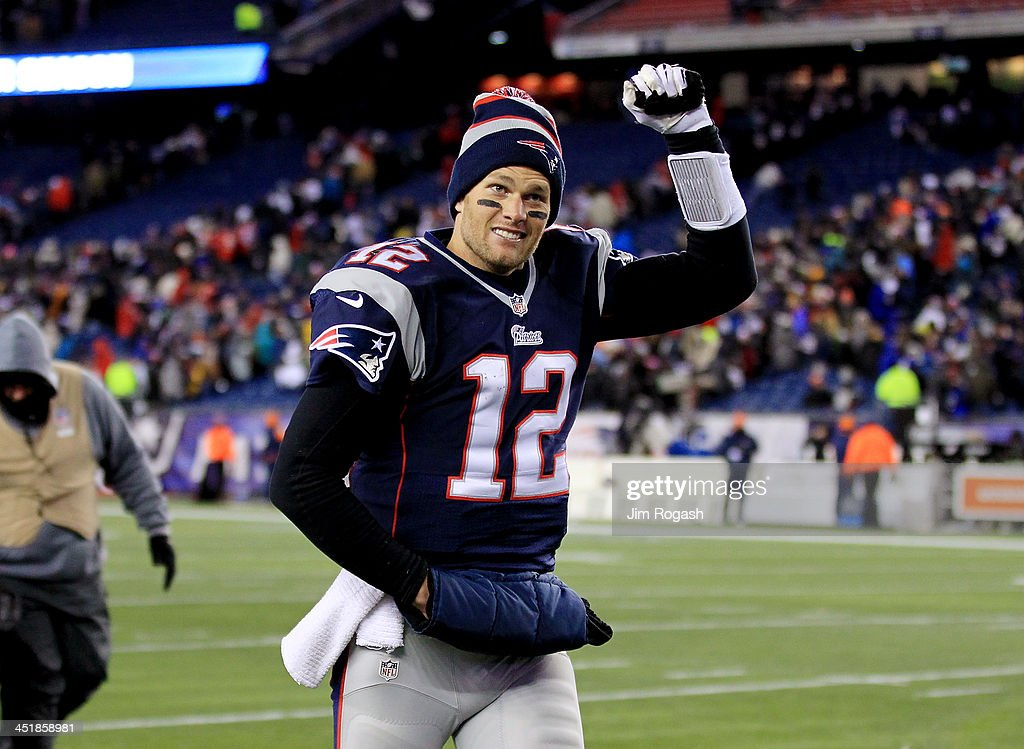 Quarterback Tom Brady #12 of the New England Patriots walks off the field after a game at Gillette Stadium on November 24, 2013 in Foxboro, Massachusetts.