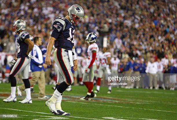 Quarterback Tom Brady of the New England Patriots walks off the field after losing to the New York Giants 1714 in Super Bowl XLII on February 3 2008...