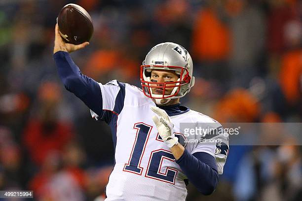 Quarterback Tom Brady of the New England Patriots warms up before a game against the Denver Broncos at Sports Authority Field at Mile High on...