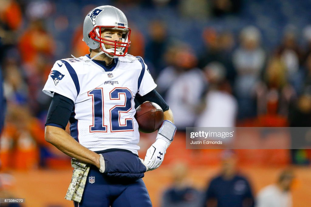 Quarterback Tom Brady #12 of the New England Patriots warms up before a game against the Denver Broncos at Sports Authority Field at Mile High on November 12, 2017 in Denver, Colorado.
