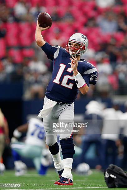 Quarterback Tom Brady of the New England Patriots warms up on the field before the NFL game against the Dallas Cowboys at ATT Stadium on October 11...