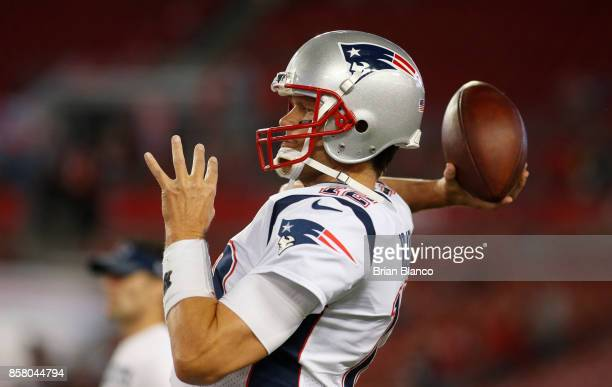 Quarterback Tom Brady of the New England Patriots warms up on the field before the start of an NFL football game against the Tampa Bay Buccaneers on...