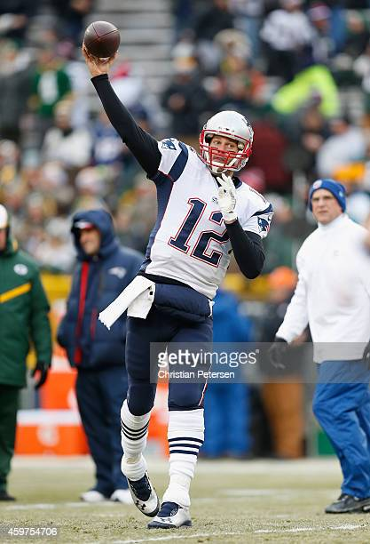 Quarterback Tom Brady of the New England Patriots warms up prior to the NFL game against the Green Bay Packers at Lambeau Field on November 30 2014...