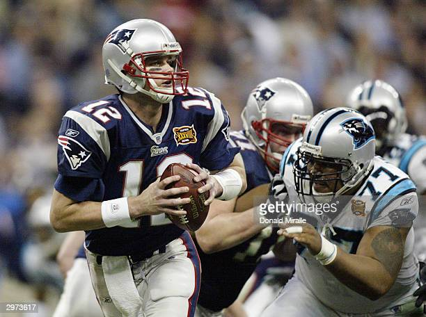 Quarterback Tom Brady of the New England Patriots with the ball against the Carolina Panthers during Super Bowl XXXVIII at Reliant Stadium on...
