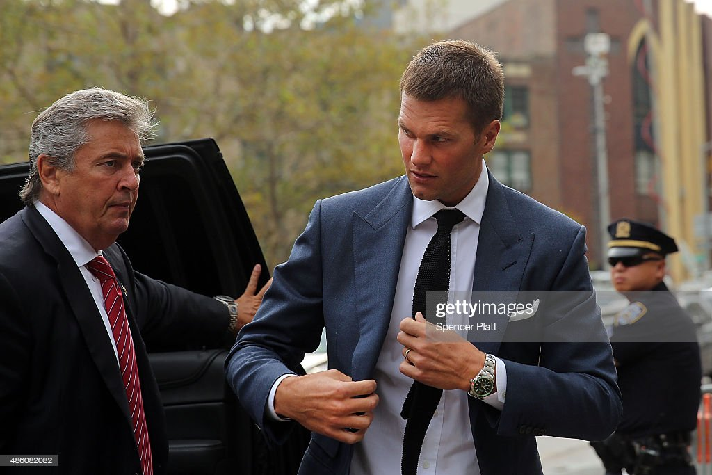 Quarterback Tom Brady (R) of the New Englang Patriots arrives at federal court to contest his four game suspension on August 31, 2015 in New York City. US District Judge Richard Berman has required NFL commissioner Roger Goodell and Brady to be present in court on Monday when the NFL and NFL Players Association reconvene their dispute over Brady's four-game Deflategate suspension.